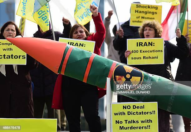 Iranian opposition supporters stage a demonstration displaying a fake nuclear missile ahead of ongoing nuclear talks between EU foreign ministers and...