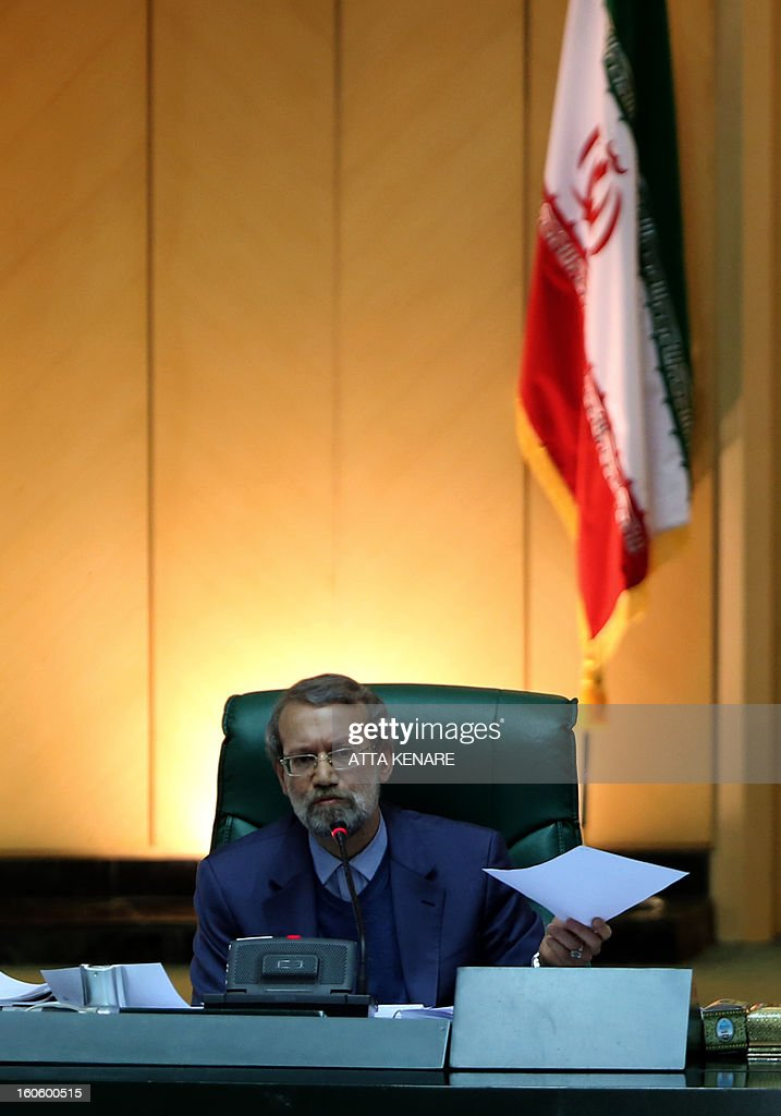 Iranian Parliament Speaker Ali Larijani delivers a speech to the parliament in Tehran on February 3, 2013. Heated debates between Iran's government and parliament came out over the impeachment of labour and social welfare minister, Abdolreza Sheikholeslam, with heads of the two branches accusing each other of corruption and abuse of power.