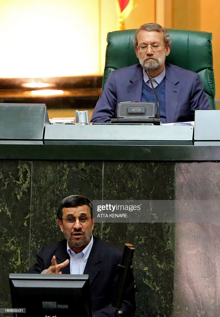 Iranian Parliament Speaker Ali Larijani (top) listens to Iranian President Mahmoud Ahmadinejad delivering his speech after they summoned the labour and social welfare minister Abdolreza Sheikholeslam to the parliament in Tehran on February 3, 2013. A large majority of MPs voted in a heated parliament session, broadcast on state radio, to remove Sheikholeslam, for refusing to sack a controversial figure, Saeed Mortazavi.
