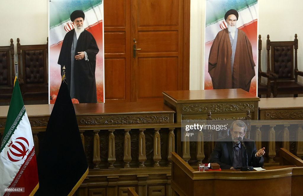 Iranian Parliament Speaker, <a gi-track='captionPersonalityLinkClicked' href=/galleries/search?phrase=Ali+Larijani&family=editorial&specificpeople=572030 ng-click='$event.stopPropagation()'>Ali Larijani</a>, speaks to the media during a press conference in Tehran on March 16,2015. Iranian MPs will not derail a nuclear deal with the West, as US lawmakers have threatened to, if the country's supreme leader gives it his backing, Larijani said. On the background, portraits of Iran's supreme leader, Ayatollah Ali Khamenei (L) and Iran's founder of Islamic Republic, Ayatollah Ruhollah Khomeini (R). AFP PHOTO / SEDA RAVANDI