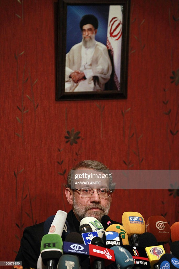 Iranian Parliament speaker Ali Larijani speaks under a picture of Iranian supreme leader Ayatollah Ali Khamenei, during a press conference at a hotel in the Lebanese capital, Beirut on November 23, 2012. Larijani began a regional tour to find a solution to the conflict in his country's key ally, Syria.