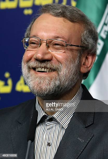 Iranian Parliament's speaker Ali Larijani smiles during a joint press conference with his Iraqi counterpart Salim alJabouri following a meeting on...