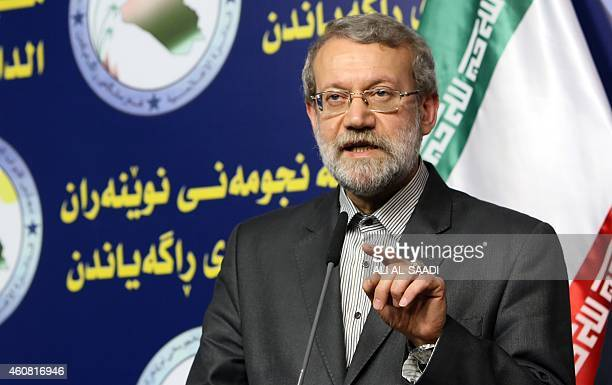 Iranian Parliament's speaker Ali Larijani speaks during a joint press conference with his Iraqi counterpart Salim alJabouri following a meeting on...