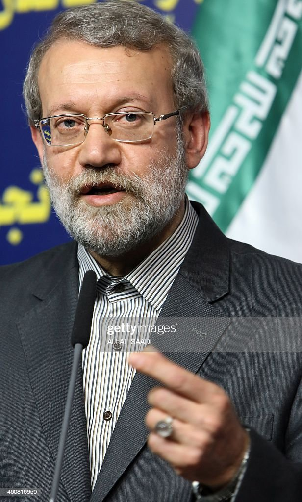 Iranian Parliament's speaker <a gi-track='captionPersonalityLinkClicked' href=/galleries/search?phrase=Ali+Larijani&family=editorial&specificpeople=572030 ng-click='$event.stopPropagation()'>Ali Larijani</a> speaks during a joint press conference with his Iraqi counterpart Salim al-Jabouri (unseen) following a meeting on December 24, 2014 in the Iraqi capital Baghdad.