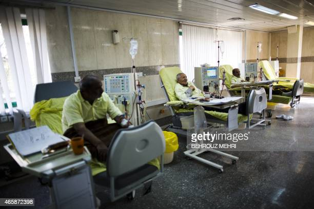Iranian patients receive treatment at the dialysis ward in the Helal Iran Clinic on March 11 2015 a day ahead of the World Kidney Day in the capital...