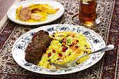 iranian cuisine, persian jeweled rice and chicken fesenjan, potato tahdig