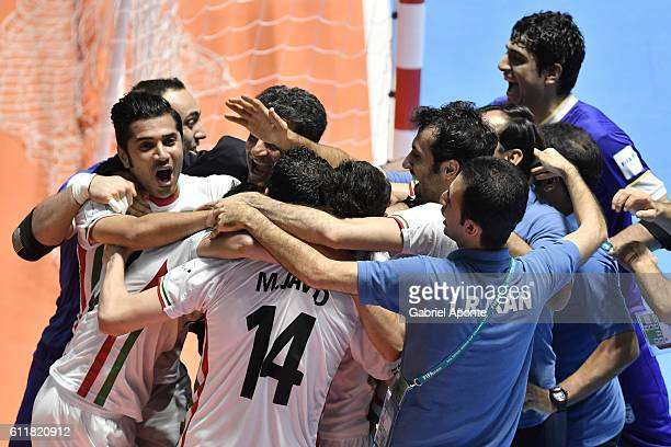 Iranian players celebrate after Mahdi Javid scores the winning penalty during the FIFA Futsal World Cup Third Place play off match between Iran and...