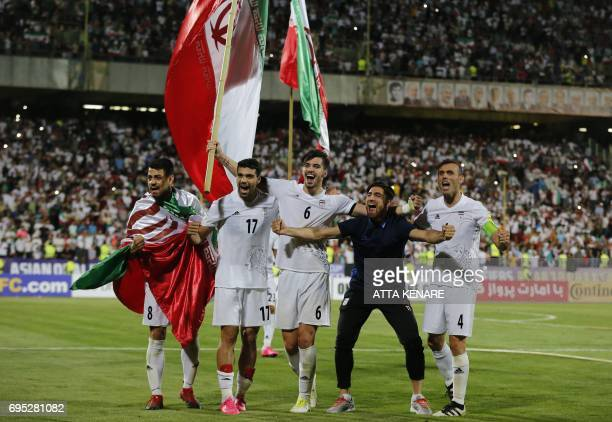 Iranian players celebrate after winning the 2018 World Cup qualifying football match between Iran and Uzbekistan at the Azadi Stadium in Tehran on...
