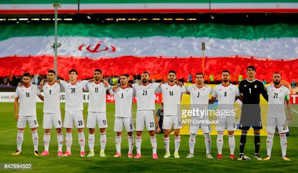 Iranian players pose prior to the FIFA World Cup 2018 qualification football match between Syria and Iran at the Azadi Stadium in Tehran on September...