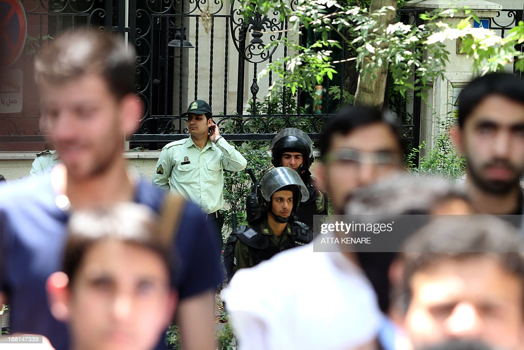 Iranian police look on during an anti-Israeli demonstration in front of the United Nations offices in Tehran, on May 6,2013, to condemn Israeli air strikes on targets near the Syrian capital Damascus. Israeli raids on Syrian targets at the weekend killed at least 15 soldiers, a watchdog said, as UN chief Ban Ki-moon led calls for restraint to prevent the war spilling over borders. AFP PHOTO/ATTA KENARE