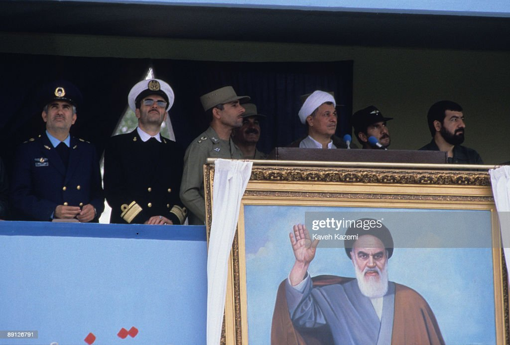 Iranian President Akbar Hashemi Rafsanjani with military commanders during an army day ceremony in Azadi Square Tehran Iran 18th April 1989 Below...