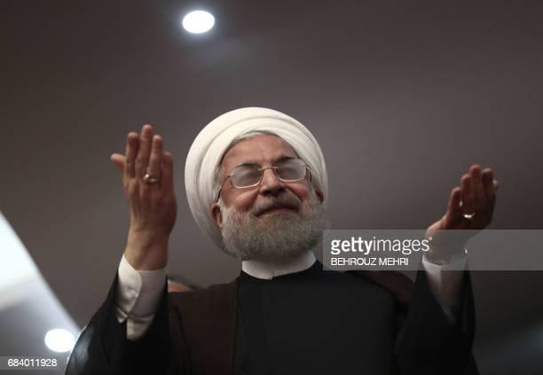 Iranian President and candidate in the upcoming presidential elections Hassan Rouhani gestures during a campaign rally in the northwestern city of...