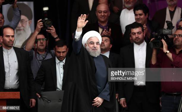 Iranian President and candidate in the upcoming presidential elections Hassan Rouhani greets his supporters at a campaign rally in Takhti stadium in...