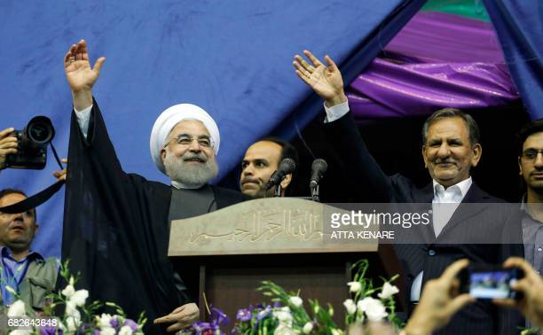Iranian President and presidential candidate Hassan Rouhani along with current vicepresident and presidential candidate Eshaq Jahangiri attend a...