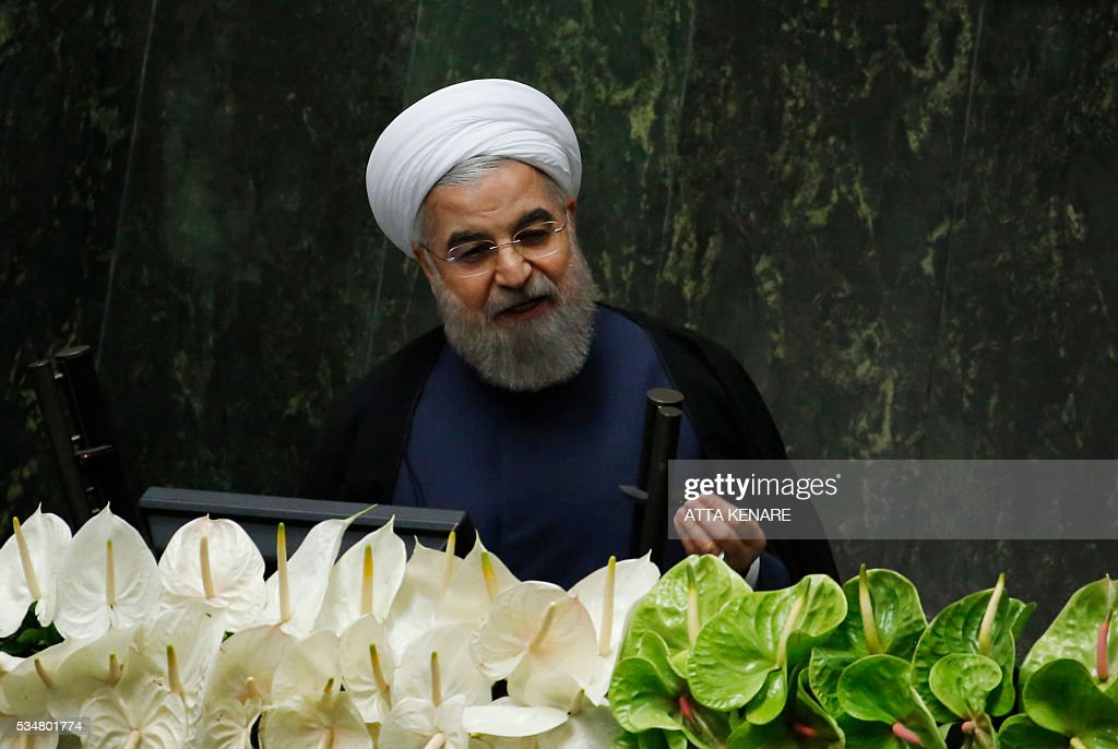 Iranian President Hasan Rouhani delivers a speech during the opening session of the new parliament in Tehran on May 28, 2016. Iranian parliamentarians met in Tehran for the first time since elections finished in April. KENARE
