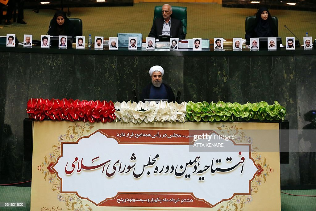 Iranian President Hasan Rouhani (C) delivers a speech during the opening session of the new parliament in Tehran on May 28, 2016. Iranian parliamentarians met in Tehran for the first time since elections finished in April. KENARE