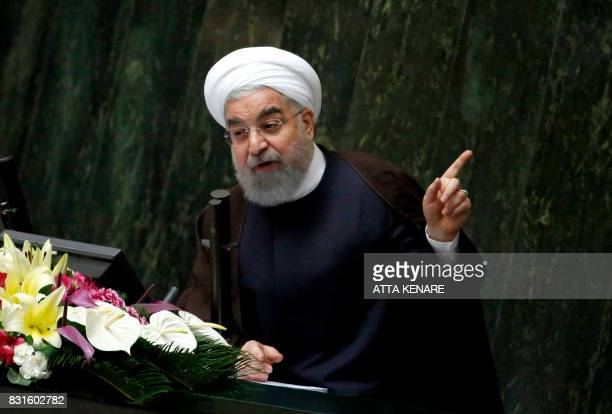 Iranian President Hassan Rouhani addresses a parliamentary session in Tehran on August 15 2017 Rouhani warned that Iran could abandon its 2015...