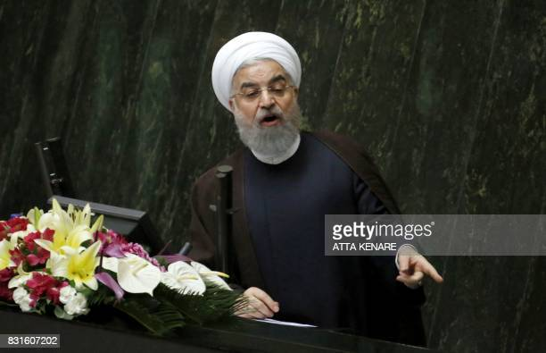 Iranian President Hassan Rouhani addresses the parliament in Tehran on August 15 2017 Rouhani warned that Iran could abandon its 2015 nuclear deal...