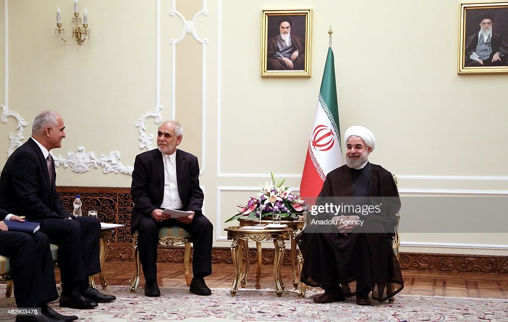 Iranian President Hassan Rouhani and Azerbaijan's Economy and Industry Minister Sahin Mustafayev meet in Tehran Iran on August 4 2015