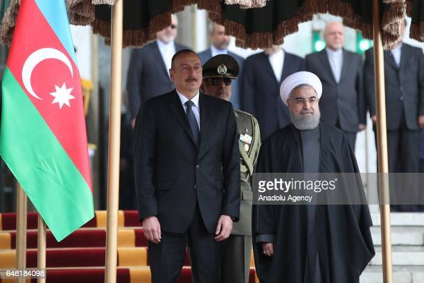 Iranian President Hassan Rouhani and Azerbaijan's President Ilham Aliyev stand in silence during an official welcoming ceremony in Tehran Iran on...
