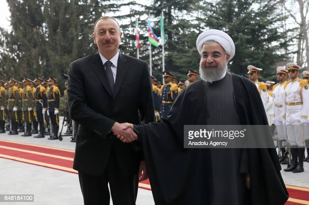Iranian President Hassan Rouhani and Azerbaijan's President Ilham Aliyev shake hands during an official welcoming ceremony in Tehran Iran on March 05...