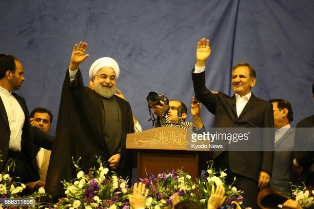 Iranian President Hassan Rouhani and First Vice President Eshaq Jahangiri respond to Rouhani's supporters in Tehran on May 13 ahead of the May 19...