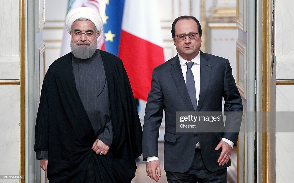 Iranian President Hassan Rouhani (L) and French President Francois Hollande arrive to attend a press conference at the Elysee Presidential Palace on January 28, 2016 in Paris, France. Hassan Rouhani is to make the first state visit to France by an Iranian president in nearly two decades following the lifting of sanctions against his country.
