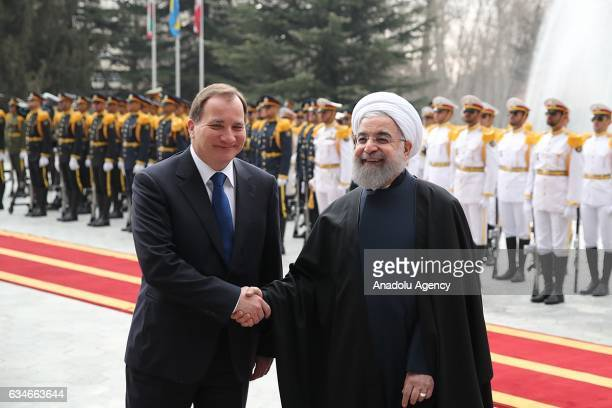 Iranian President Hassan Rouhani and Swedish Prime Minister Stefan Lofven shake hands during official welcome ceremony ahead of their meeting at...