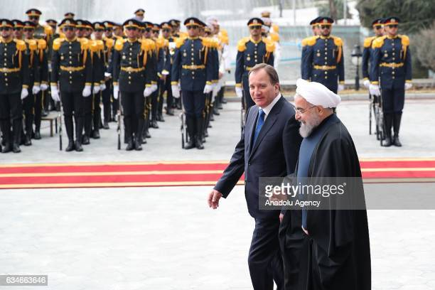 Iranian President Hassan Rouhani and Swedish Prime Minister Stefan Lofven walk past honor guards during official welcome ceremony ahead of their...