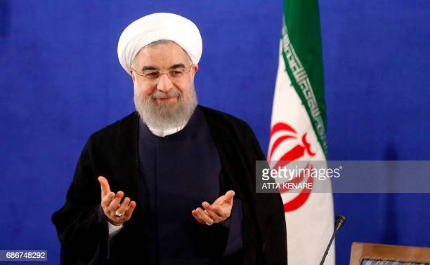 Iranian President Hassan Rouhani arrives to hold a press conference in Tehran on May 22 2017 Rouhani said that Iran does not need the permission of...