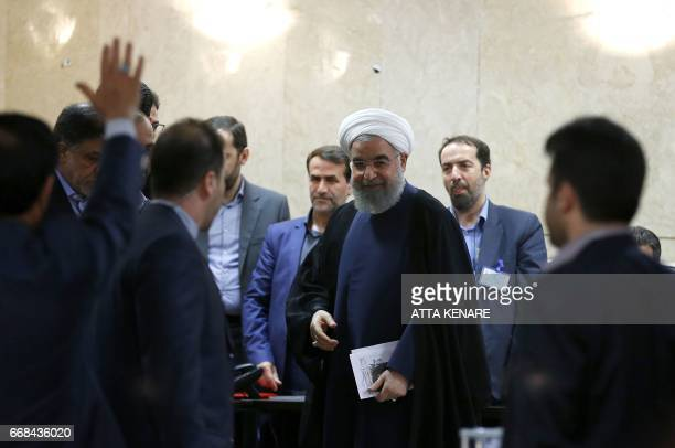 Iranian President Hassan Rouhani arrives to register to run for reelection at the interior ministry in the capital Tehran on April 14 2017 Rouhani...