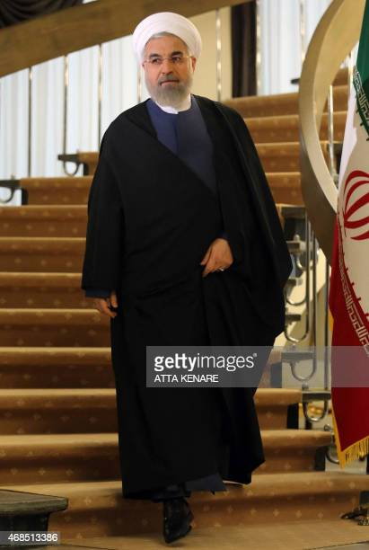 Iranian President Hassan Rouhani arrives to speak during a press conference in Tehran on April 3 2015 Iran vowed to stand by a nuclear deal with...