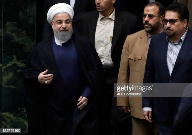 Iranian President Hassan Rouhani arrives to the parliament in Tehran on August 20 as Iran's parliament prepares to vote on the president's cabinet...