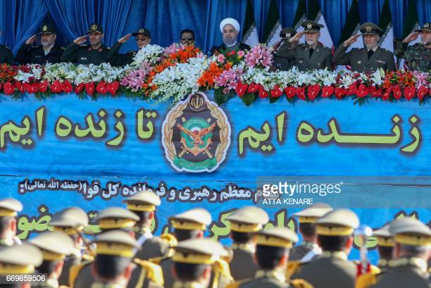 Iranian President Hassan Rouhani attend a parade on the occasion of the country's Army Day on April 18 in Tehran / AFP PHOTO / ATTA KENARE