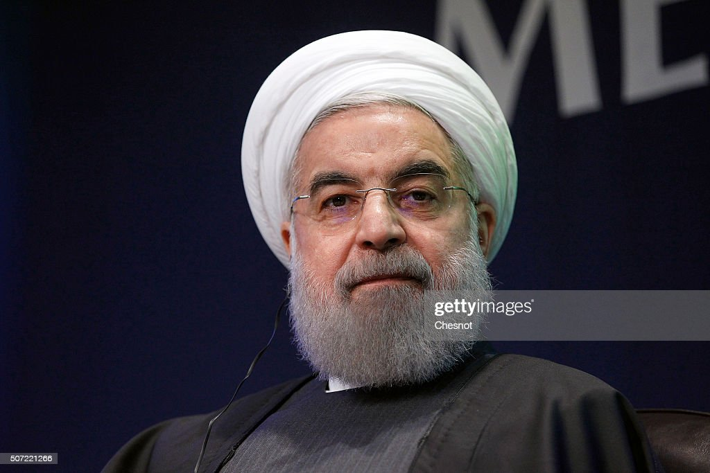 Iranian President <a gi-track='captionPersonalityLinkClicked' href=/galleries/search?phrase=Hassan+Rouhani+-+Politician&family=editorial&specificpeople=641593 ng-click='$event.stopPropagation()'>Hassan Rouhani</a> attends a meeting with the French Prime Minister Manuel Valls at the French employers association MEDEF headquarters on January 28, 2016 in Paris, France. <a gi-track='captionPersonalityLinkClicked' href=/galleries/search?phrase=Hassan+Rouhani+-+Politician&family=editorial&specificpeople=641593 ng-click='$event.stopPropagation()'>Hassan Rouhani</a> is to make the first state visit to France by an Iranian president in nearly two decades following the lifting of sanctions against his country.