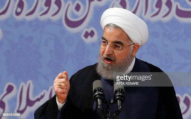 Iranian President Hassan Rouhani delivers a speech after registerimg to run for reelection at the interior ministry in the capital Tehran on April 14...
