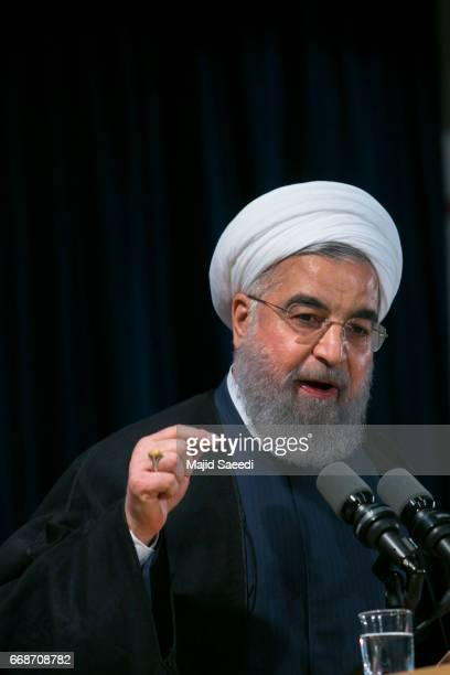 Iranian President Hassan Rouhani delivers a speech after registering to run for reelection at the interior ministry in the capital Tehran on April 14...