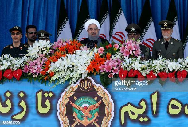 Iranian President Hassan Rouhani delivers a speech during a parade on the occasion of the country's Army Day on April 18 in Tehran / AFP PHOTO / ATTA...