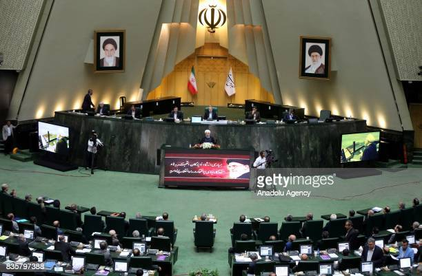 Iranian President Hassan Rouhani delivers a speech during a vote of confidence session on the President Hassan Rouhani's cabinet in Tehran on August...