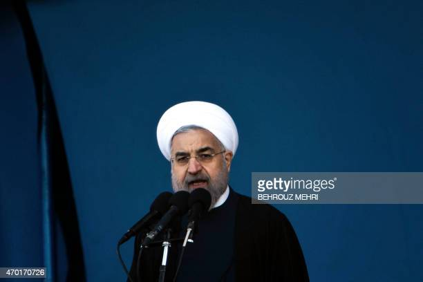 Iranian President Hassan Rouhani delivers a speech during the Army Day parade in Tehran on April 18 2015 Amid rising tension between Iran and Saudi...