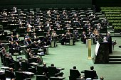Iranian President Hassan Rouhani delivers a speech to parliament before presenting the proposed annual budget in Tehran on December 7 2014 Iran's...