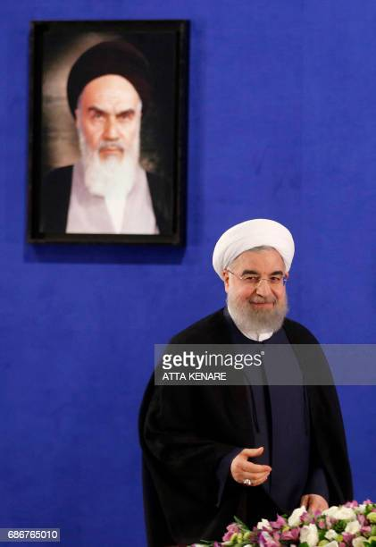 Iranian President Hassan Rouhani holds a press conference in Tehran on May 22 2017 Rouhani said that Iran does not need the permission of the United...