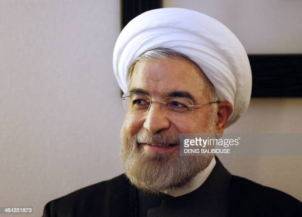 Iranian President Hassan Rouhani listens to World Economic Forum Executive Chairman during a meeting at the WEF in Davos on January 22 2014 Top...