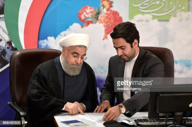 Iranian President Hassan Rouhani registers his candidacy for Iran's upcoming presidential elections on 19 May at the interior ministry in Tehran Iran...