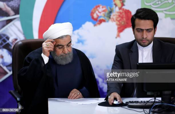 Iranian President Hassan Rouhani registers to run for reelection at the interior ministry in the capital Tehran on April 14 2017 Rouhani the driving...