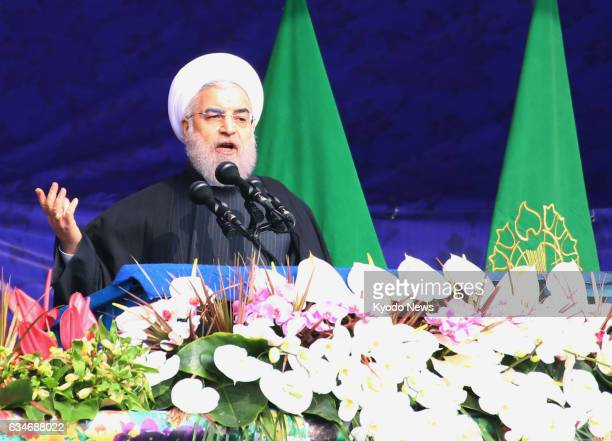 Iranian President Hassan Rouhani speaks during a ceremony in Tehran to commemorate the 38th anniversary of Iran's Islamic fundamentalist revolution...