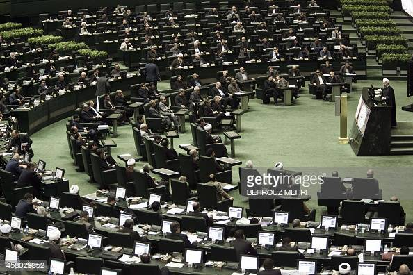 Iranian President Hassan Rouhani speaks during a parliament session in Tehran on October 29 to defend his nominee for the ministry of Science...