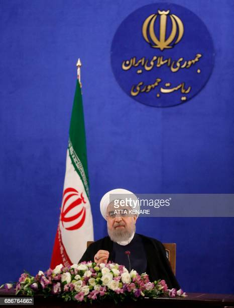 Iranian President Hassan Rouhani speaks during a press conference in Tehran on May 22 2017 Rouhani said that Iran does not need the permission of the...