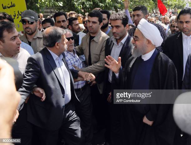 Iranian president Hassan Rouhani takes part in a rally marking alQuds Day in Tehran on June 23 2017 Chants against the Saudi royal family and the...