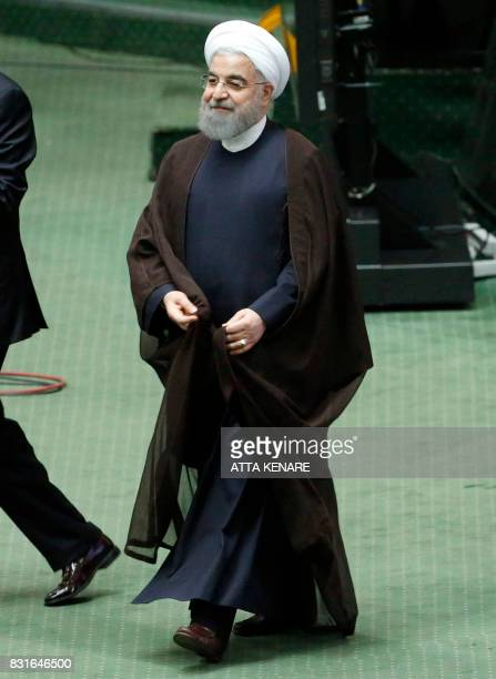 Iranian President Hassan Rouhani walks after addressing the parliament in Tehran on August 15 2017 Rouhani warned that Iran could abandon its 2015...